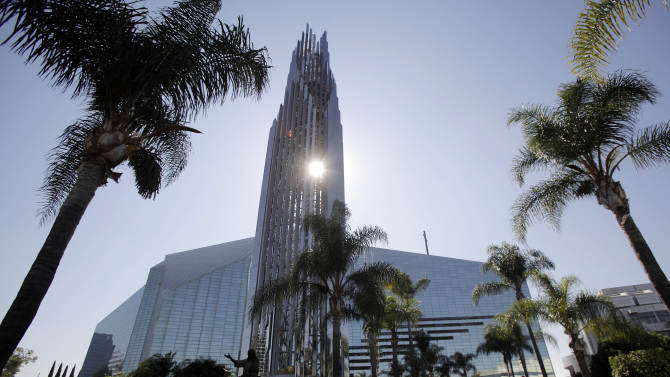 """This Oct. 27, 2011 photo shows the Crystal Cathedral in Garden Grove, Calif.  As the ministry famous for its """"Hour of Power"""" television program muddles through bankruptcy, churchgoers face the possibility of seeing the property sold to the Roman Catholic Diocese of Orange and being forced to move to a new location.  (AP Photo/Jae C. Hong)"""