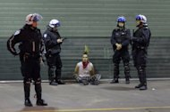 A student sits on the ground after being arrested by police in Montreal. Small groups of protesters clashed with police on the streets of Montreal amid festivities leading up to Sunday&#39;s Formula One Grand Prix