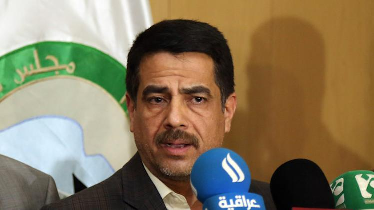 Falah al-Qaisi, a member of the Baghdad provincial council, speaks to the media in Baghdad, Saturday, July 26, 2014. Gunmen traveling in 10 black SUVs seized Riyadh al-Adhdah, the head of the Baghdad Provincial Council and a senior Sunni politician who had previously been jailed on terrorism charges from his home in Baghdad on Saturday, police officers said. (AP Photo/Karim Kadim)
