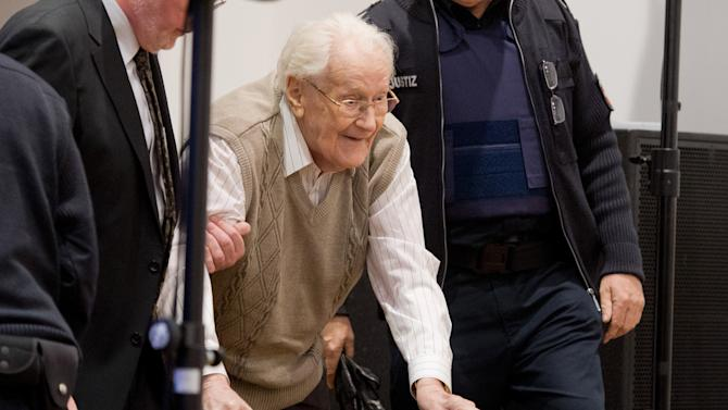Defendant Oskar Groening arrives in the court room in Lueneburg, northern Germany, Tuesday, April 21, 2015. The  93-year-old former Auschwitz guard faces trial on 300,000 counts of accessory to murder, in a case that will test the argument that anyone who served at a Nazi death camp was complicit in what happened there. (Julian Stratenschulte/Pool Photo via AP)