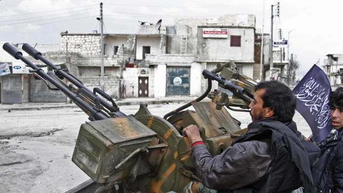 In this Friday February 8, 2013, photo, Free Syrian Army fighters sit behind their anti-aircraft weapon in Aleppo, Syria. Syrian rebels brought their fight within a mile of the heart of Damascus on Friday, seizing army checkpoints and cutting a key highway with a row of burning tires as they pressed their campaign for the heavily guarded capital, considered the likely endgame in the nearly 2-year-old civil war. (AP Photo/Abdullah al-Yassin)