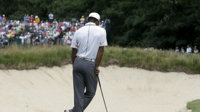 Tiger Woods reacts after a shot on the eighth hole during the second round of the U.S. Open golf tournament at Merion Golf Club, Friday, June 14, 2013, in Ardmore, Pa. (AP Photo/Gene J. Puskar)