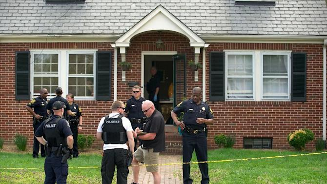 Fredericksburg police investigate the scene of what's being described as a homicide in the 1900 block of Washington Avenue in Fredericksburg, VA, Friday, April 17, 2015. Fredericksburg Police Department Public Information Officer Natatia Bledsoe said Steven Vander Briel, 30,  was arrested Friday after a two-hour search.  Police have charged Vander Briel with first-degree murder and abduction in the death of Grace Rebecca Mann Friday. (The Free Lance Star, Peter Cihelka via AP)