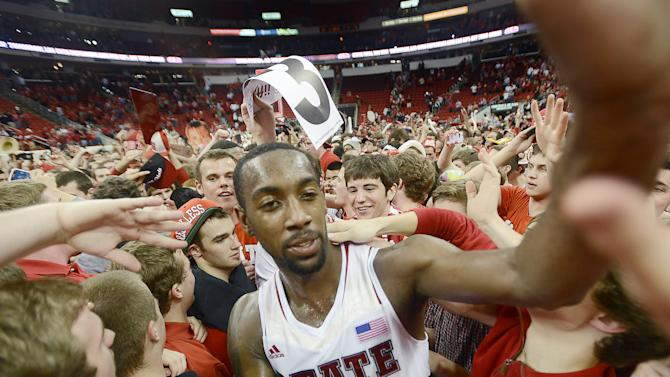 CORRECTS SOURCE TO THE HERALD-SUN, NOT THE STAR-NEWS - North Carolina State's C.J. Leslie celebrates with fans after the Wolfpack's  84-76 win over top-ranked Duke in Raleigh, N.C., Saturday, Jan. 12, 2013. (AP Photo/The Herald-Sun, Bernard Thomas)
