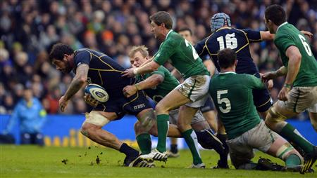 Ireland's O'Gara tackles Scotland's Hamilton during their Six Nations rugby match at Murrayfield Stadium in Edinburgh
