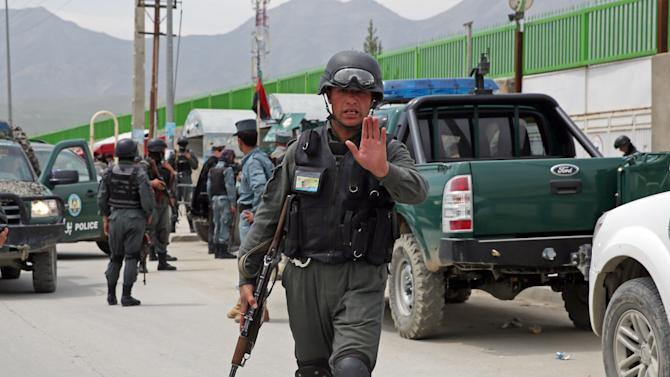 An Afghan policeman outside the Cure International Hospital in Kabul