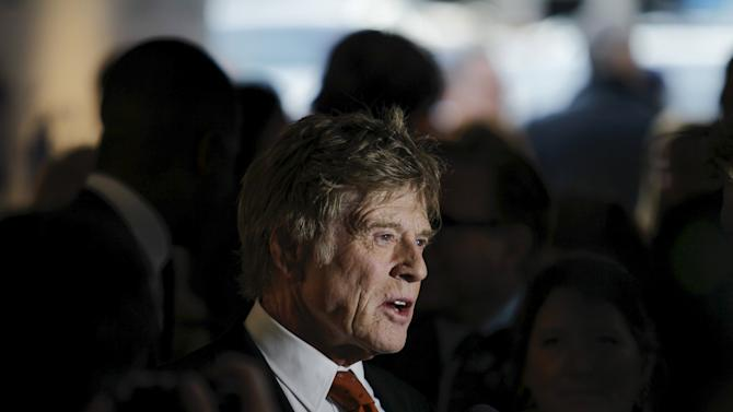 Actor Redford speaks to the media as he arrives to attend the Chaplin award at Alice Tully Hall in New York