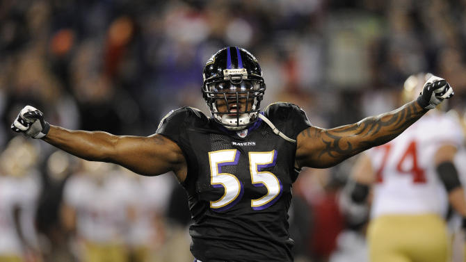 Baltimore Ravens outside linebacker Terrell Suggs celebrates after the Ravens forced the San Francisco 49ers to punt on fourth down during the first half of an NFL football game in Baltimore on Thursday, Nov. 24, 2011. (AP Photo/Nick Wass)