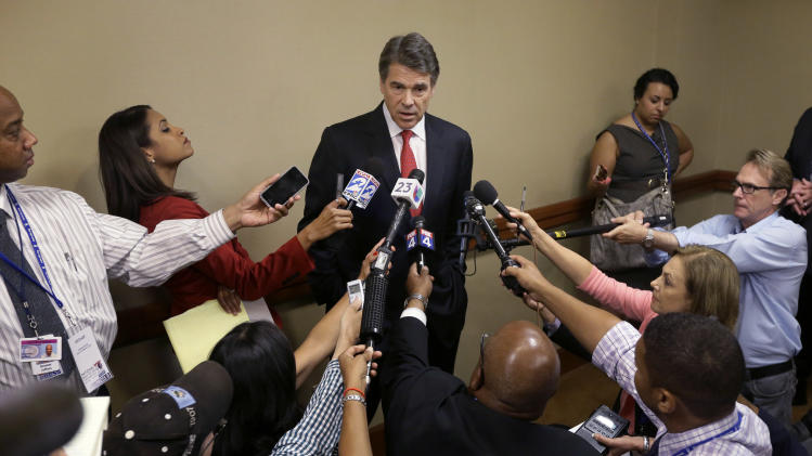 Perry, filibuster star clash over Texas abortions