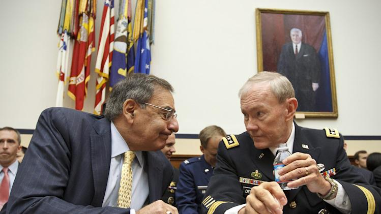 Defense Secretary Leon Panetta and Joint Chiefs Chairman Gen. Martin Dempsey confer on Capitol Hill in Washington, Thursday, April, 19, 2012, prior to testifying before the House Armed Services Committee hearing on recent developments with the crisis in Syria.    (AP Photo/J. Scott Applewhite)