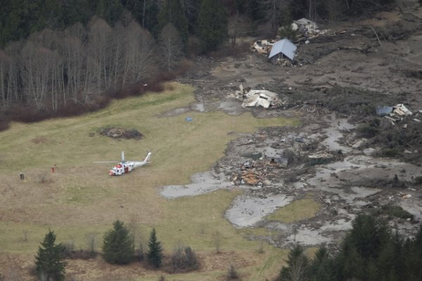 Handout aerial view of the landslide that is covering State Route 530 ...