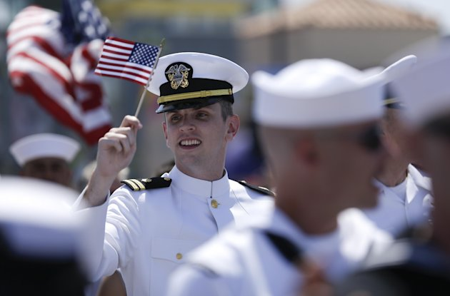 A sailor waves a flag during the gay pride parade Saturday, July 21, 2012, in San Diego. For the first time ever, U.S. service members marched in a gaypride event decked out in uniform Saturday, after a recent memorandum from the Defense Department to all military branches made an allowance for the San Diego parade - even though its policy generally bars troops from marching in uniform in parades. (AP Photo/Gregory Bull)