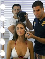 Arab-Israeli model Huda Naccache gets her make-up done by stylist Michel Turgeman at a studio in Haifa in northern Israel. The cover shoot for Lilac was the first time an Arabic magazine here has put a model in a bikini on its cover