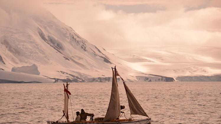 """In this Jan. 23, 2013 photo released by Shackleton Epic, adventurers aboard their boat Alexander Shackleton cross the Southern Ocean. A modern-day team of six led by Tim Jarvis and Barry """"Baz"""" Gray used similar equipment and clothes to re-enact a 1916 expedition led by Ernest Shackleton to save his crew after their ship got stuck in Antarctica's icy waters. They reached an old whaling station on remote South Georgia island Monday, Feb. 11, 2013, 19 days after leaving Elephant Island. Just as Shackleton did in 1916, Jarvis and his team sailed 800 nautical miles across the Southern Ocean in a small lifeboat and then climbed over crevasse-filled mountains in South Georgia. (AP Photo/Shackleton Epic, Si Wagen)"""