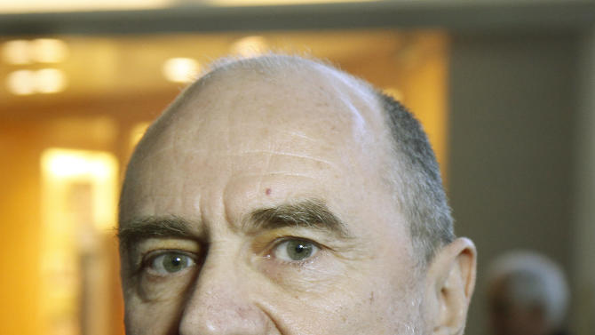 Herman Nackaerts of the International Atomic Energy Agency,IAEA, Deputy Director General and Head of the Department of Safeguards, arrives for his flight to Iran at Vienna's Schwechat airport, Austria, on Saturday, Jan. 28, 2012. (AP Photo/Ronald Zak)