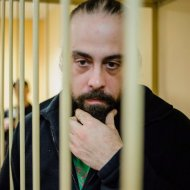 Canadian activist Alexandre Paul listens to a court ruling in a defendants' cage in a court room in St. Petersburg, Russia, Thursday, Nov. 21, 2013. THE CANADIAN PRESS/AP,Greenpeace International, Vladimir Baryshev
