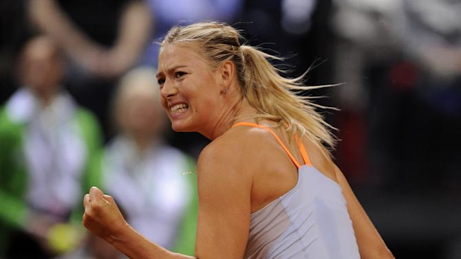 Maria Sharapova from Russia clinches the fist during the final of the WTA tennis Porsche GP against Na Li from China in Stuttgart, Germany, Sunday, April 28, 2013. (AP Photo/Daniel Maurer)
