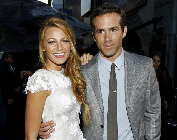"FILE - This June 15, 2011 file photo shows actors Blake Lively, left, and Ryan Reynolds at the premiere of ""Green Lantern"" in Los Angeles. Reynolds wed Blake Lively in Mount Pleasant, S.C., Sunday, Sept. 9, 2012, at Boone Hall Plantation, according to a person familiar with the ceremony who requested anonymity because they were not authorized to speak on the matter. While it's Lively's first marriage, Reynolds was previously married to Scarlett Johansson. Their divorce was finalized last summer after three years of marriage. Lively and Reynolds both starred in last year's ""Green Lantern."" (AP Photo/Matt Sayles, file)"