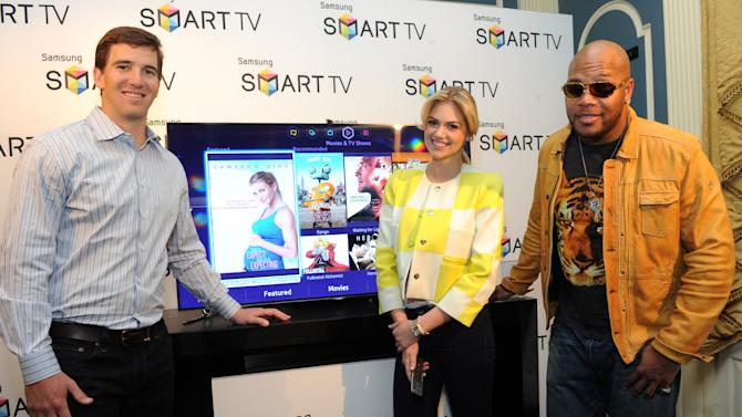 IMAGE DISTRIBUTED FOR SAMSUNG - Left to right,  Football quarterback Eli Manning, model Kate Upton and hip-hop artist Flo Rida join Samsung at its launch event for the 2013 line of Smart TVs, Wednesday, March 20, 2013, in New York.  Samsung's new line allows the viewer to discover more of the TV they love with a simpler, more personalized and smarter way of watching TV.  (Photo by Diane Bondareff/Invision for Samsung/AP Images)