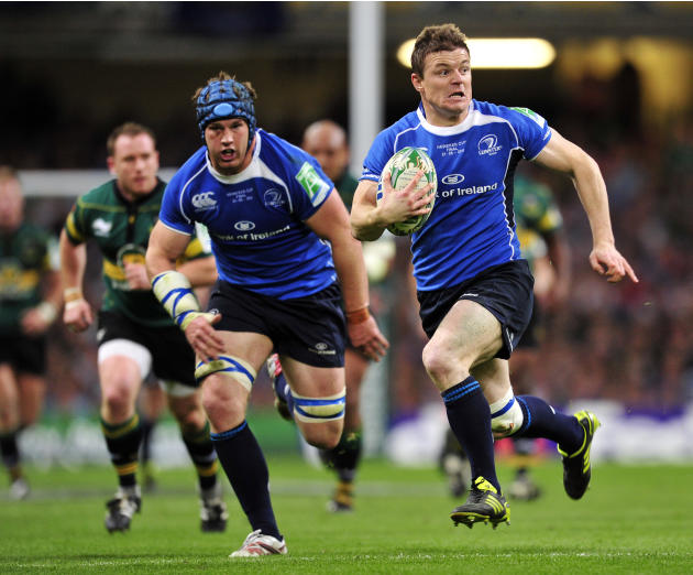 Leinster's Irish centre Brian O'Driscoll runs with the ball during their Heineken Cup Final match against Northampton Saints at the Millennium Stadium, Cardiff, Wales, on May 21, 2011. AFP PHOTO/GLYN