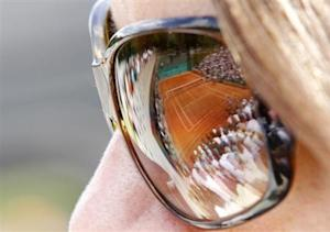 A spectator watches a match at the French Open tennis tournament at Roland Garros in Paris