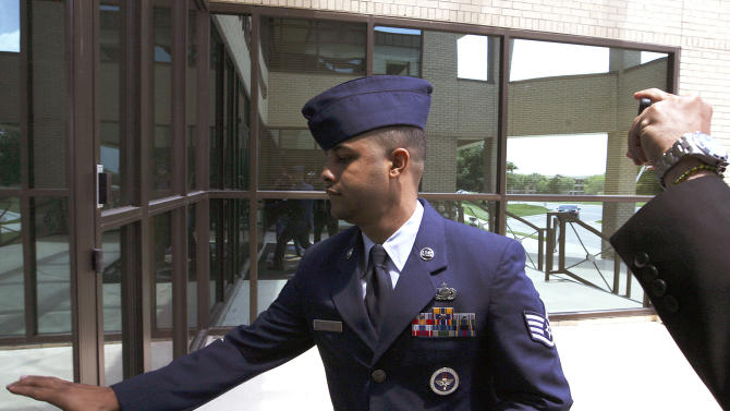 FILE - In this July 16, 2012 file photo, U.S. Air Force Staff Sgt. Luis A. Walker arrives from a lunch break during his court martial at Lackland Air Force Base in San Antonio. A seven-member jury of military personnel is set to hear closing arguments in a case considered the cornerstone of a massive sex scandal at an Air Force base in Texas. Walker is among 12 instructors at Lackland Air Force Base in San Antonio who are being investigated, and faces the most serious charges _ seven counts, including rape and aggravated sexual assault. If convicted, Walker could get life in prison. (AP Photo/The San Antonio Express-News, Jerry Lara, File) RUMBO DE SAN ANTONIO OUT; NO SALES