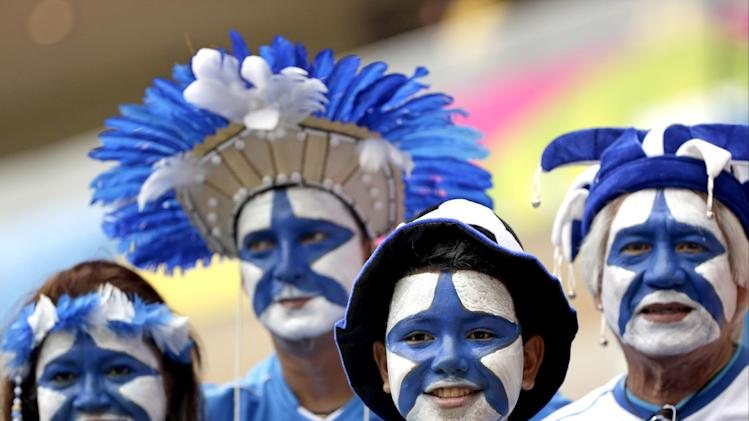 Honduras fans wait for the start of the group E World Cup soccer match between Honduras and Switzerland at the Arena da Amazonia in Manaus, Brazil, Wednesday, June 25, 2014