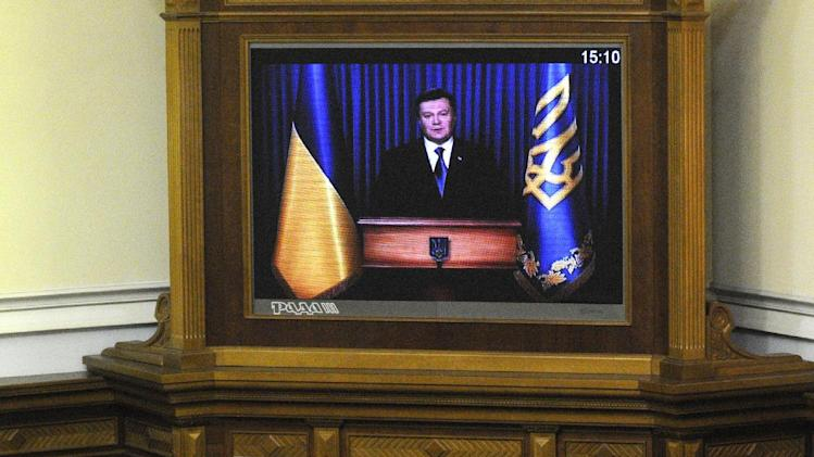 President Viktor Yanukovych addresses a half-empty parliament via a linkup after his ally Mykola Azarov was approved as Prime Minister in Kiev, Ukraine, Thursday, Dec. 13, 2012. (AP Photo/Sergei Chuzavkov)