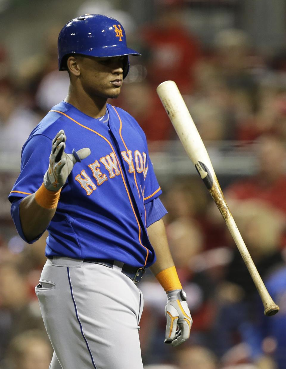 New York Mets' Juan Lagares flips his bat after striking out against Cincinnati Reds relief pitcher Aroldis Chapman in the ninth inning of a baseball game, Monday, Sept. 23, 2013, in Cincinnati. Cincinnati won 3-2 in 10 innings. (AP Photo/Al Behrman)