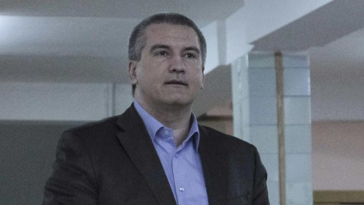 Crimean PM Aksyonov casts his ballot during voting in a referendum at a polling station in Simferopol