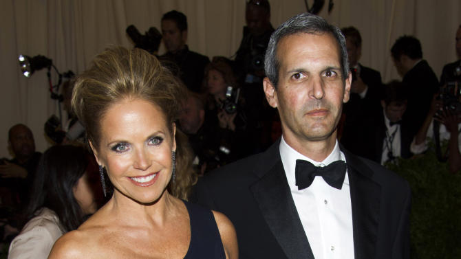 "FILE - In this May 6, 2013, file photo, TV personality Katie Couric, left, and John Molner attend The Metropolitan Museum of Art's Costume Institute benefit celebrating ""PUNK: Chaos to Couture"" in New York. Couric has married Molner in a small ceremony at her East Hampton home. People magazine reports the former ""Today"" host and Molner took the vows on Saturday, June 21, 2014, in front of 50 guests. (Photo by Charles Sykes/Invision/AP, File)"