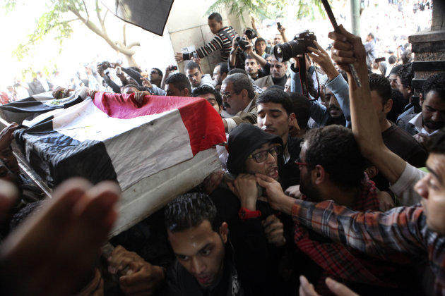 Egyptians carry the body of Gaber Salah, who was who was killed in clashes with security forces, inside a mosque for funeral prayers in Cairo, Egypt, Monday, Nov. 26, 2012. Thousands marched through T
