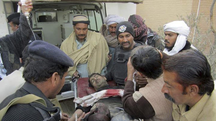 "Inspector Inayat Ullah, who is nicknamed ""Tiger"" and is head of the district bomb squad, is taken to hospital on a stretcher in Dera Ismail Khan"