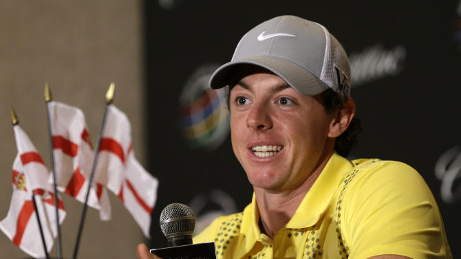 Rory McIlroy, of Northern Ireland, smiles  during a news conference at the World Golf Championships Cadillac Championship, in Doral, Fla., Wednesday March 6, 2013.  (AP Photo/Alan Diaz)