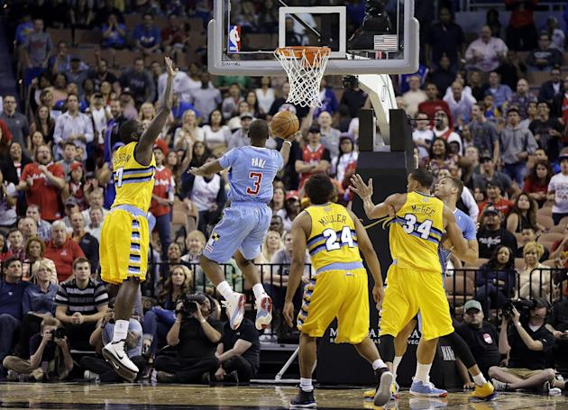 The Los Angeles Clippers' Chris Paul sinks a game-tying shot during the final seconds of the second half of a preseason NBA basketball game against the Denver Nuggets on Saturday, Oct. 19, 2013, in La