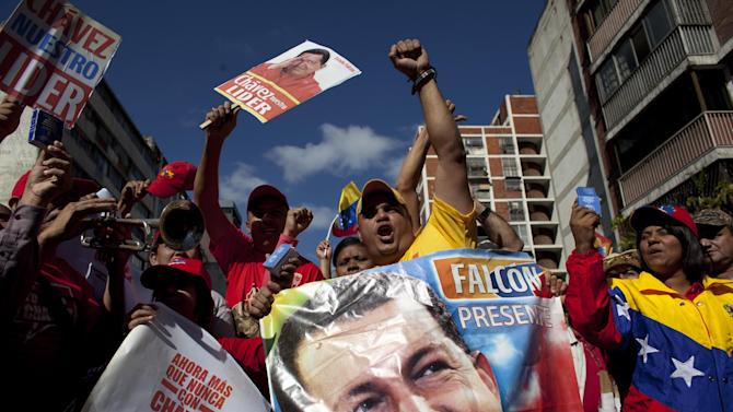 Supporters of Venezuela's President Hugo Chavez chant slogans at a rally in Caracas, Venezuela, Thursday, Jan. 10, 2013. Supporters of Chavez rallied outside his presidential palace in an exuberant symbolic inauguration for a leader too ill to return home for the real thing. The government organized the unusual show of support for the cancer-stricken leader on the streets outside Miraflores Palace on what was supposed to be his inauguration day.  (AP Photo/Ariana Cubillos)