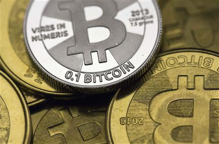 Bitcoin enthusiast Mike Caldwell's coins are pictured at his office in this photo illustration in Sandy