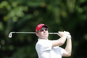 Matteson of the U.S. tees off on the first hole during the third round of the Malaysia's Asia Pacific Classic golf tournament in Kuala Lumpur