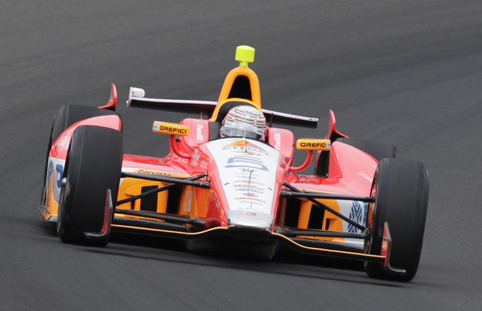 E.J. Viso, of Venezuela, drives through the first turn during practice for the Indianapolis 500 auto race at the Indianapolis Motor Speedway in Indianapolis, Friday, May 17, 2013. (AP Photo/AJ Mast)