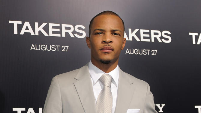 """FILE - In this Aug. 4, 2010 file photo, rapper Tip """"T.I."""" Harris, a cast member in the film """"Takers,"""" poses at the premiere of the film in Los Angeles. T.I. might have made strides outside of rap, but the 31-year-old said he is still passionate about recording music. His eighth album, """"Trouble Man,"""" will """"tentatively"""" be out in December 2012. (AP Photo/Chris Pizzello, file)"""