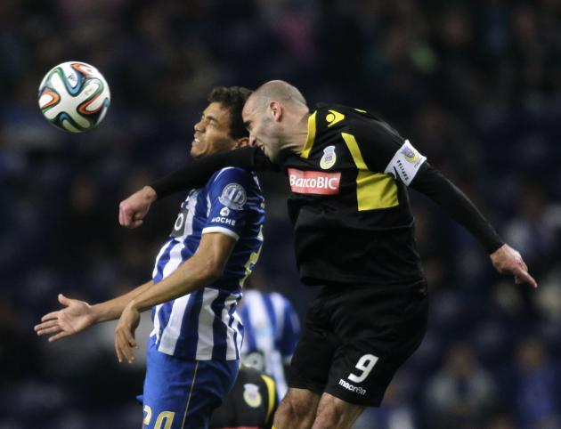 Porto's Eduardo jumps for the ball against Arouca's Amaro during their Portuguese Premier League soccer match in Porto