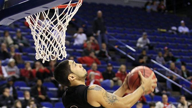 Louisville guard Peyton Siva (3) shoots during practice for the second round of the NCAA college basketball tournament, Wednesday, March 20, 2013, in Lexington, Ky. Louisville is scheduled to play North Carolina A&T Thursday. (AP Photo/James Crisp)