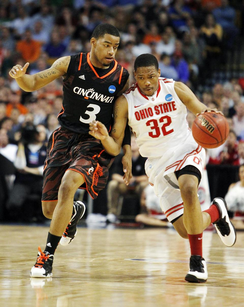 Ohio State guard Lenzelle Smith, Jr. (32) drives against Cincinnati guard Dion Dixon (3) in the first half of an East Regional semifinal game in the NCAA men's college basketball tournament, Thursday, March 22, 2012, in Boston. (AP Photo/Michael Dwyer)