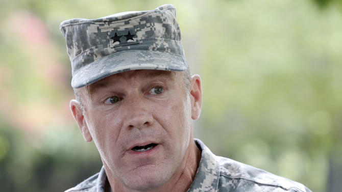 Army Maj. Gen. Stephen Lyons speaks during a news conference at the base in Fort Lee, Va., Monday, Aug. 25, 2014. A female soldier with a gun inside a key building at the Army base turned the weapon on herself, causing an injury, but didn't wound any others as the heavily trafficked base temporarily went on lockdown Monday morning. (AP Photo/Steve Helber)