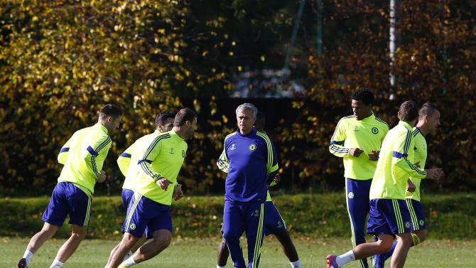 Chelsea's manager Mourinho talks to Ivanovic during a training session in Cobham