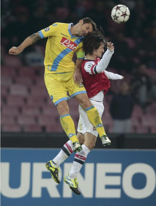 Napoli's Maggio challenges Arsenal's Rosicky during their Champions League soccer match at San Paolo stadium in Naples
