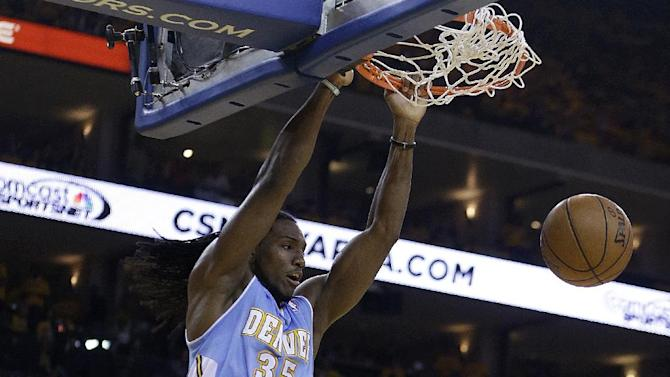 Denver Nuggets' Kenneth Faried (35) scores against the Golden State Warriors during the first half of Game 3 in a first-round NBA basketball playoff series on Friday, April 26, 2013, in Oakland, Calif. (AP Photo/Ben Margot)