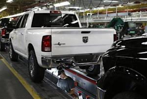 Chrysler Group assembly staff works below 2014 Dodge Ram pickup truck at the Warren Assembly Plant in Warren