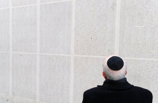 <p>A Jewish pensioner visist the Shoah memorial in Paris. French far-right leader Marine Le Pen has called for a ban on wearing Muslim veils and Jewish skullcaps in public, adding to religious tensions sparked by cartoons of the Prophet Mohammed.</p>