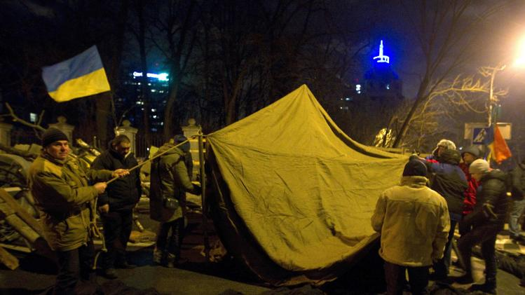 Pro-European integration protestors block a road and build a barricade near the Ministry of Internal Affairs in Kiev